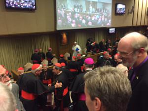The Pope packing up his things at Synod's end after he'd given another stirring talk. Cardinal Pell can also be seen. A bit like Where's Wally?