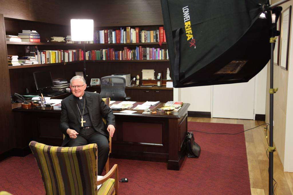 Archbishop Mark preparing to talk to The Project on happiness